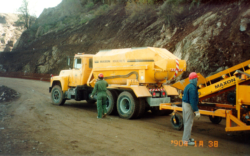 Truck-mounted Maxcrete transporter feeds concrete to...